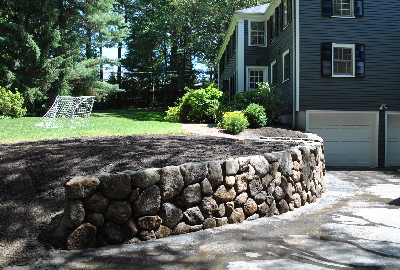 Retaining walls the new stone age for River rock wall